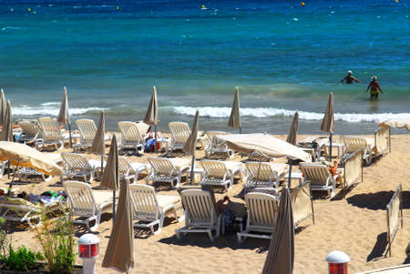 affluence: Sandy beach along Croisette promenade in Cannes France Stock Photo