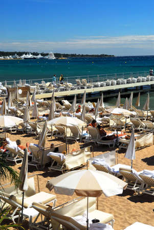 View on the beach from Croisette promenade in Cannes, France photo