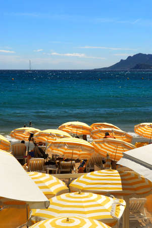 View on the beach from Croisette promenade in Cannes France photo