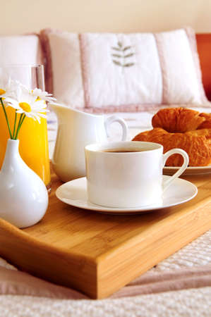Tray with breakfast on a bed in a hotel room Stock Photo - 3069533