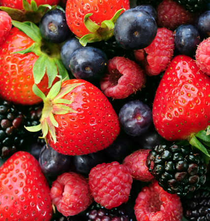 Background of assorted fresh berries close up photo