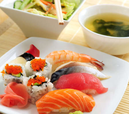 Sushi lunch with miso soup and green salad photo