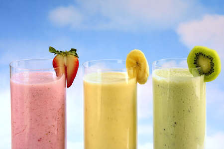 berry smoothie: Assorted fruit and berry smoothies on blue sky background