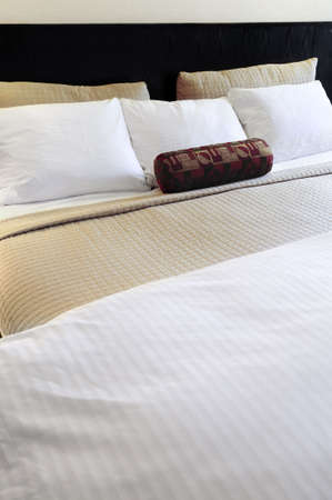 Comfortable bed in upscale hotel close up Reklamní fotografie