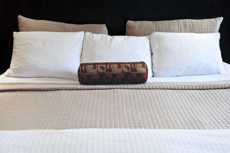 comfortable: Comfortable bed in upscale hotel close up Stock Photo