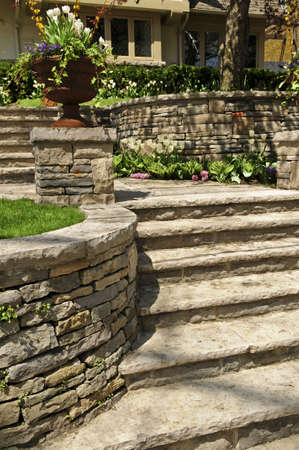 wall decor: Natural stone landscaping in front of a house