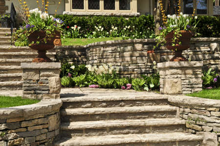 Natural stone landscaping in front of a house photo