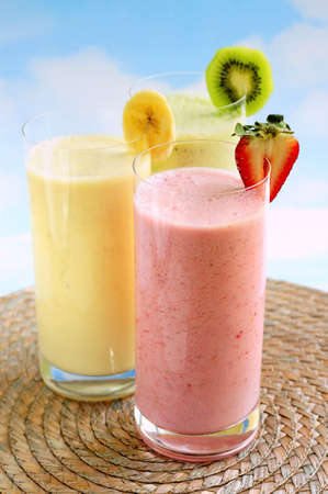 Assorted fruit and berry smoothies on blue sky background Stock Photo - 3102141