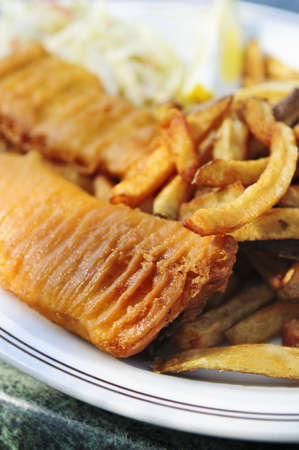 Fish and chips on a plate with coleslaw Stock Photo - 3128638