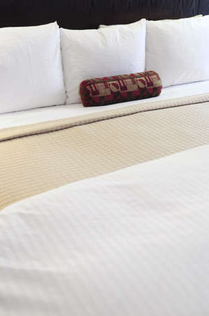 upscale: Comfortable bed in upscale hotel close up Stock Photo