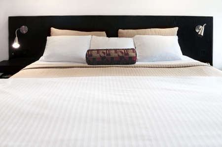 Comfortable bed in upscale hotel close up 免版税图像