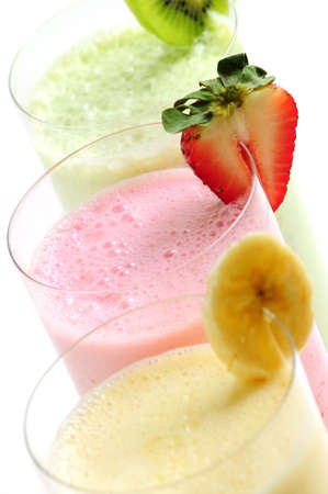 Assorted fruit smoothies close up on white background photo