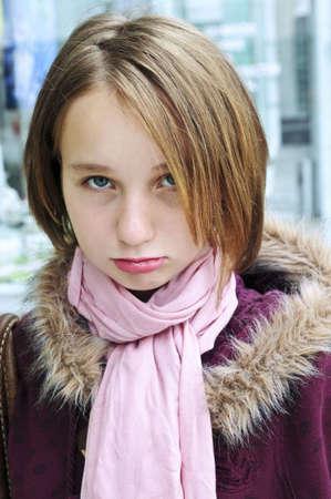 pouty: Portrait of a teenage girl making a pouty face