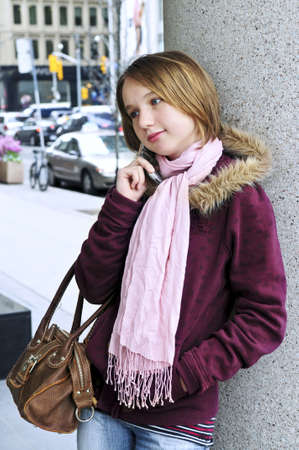 Teenage girl talking on cell phone outside Stock Photo - 3125218