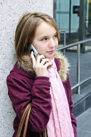 Teenage girl talking on cell phone outside Stock Photo - 3125214