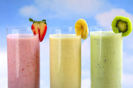 fruit shake: Assorted fruit and berry smoothies on blue sky background