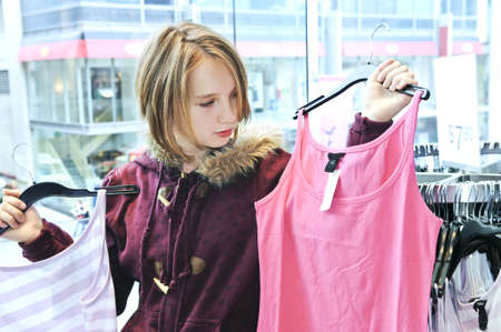 Teenage girl shopping for clothes and accessories