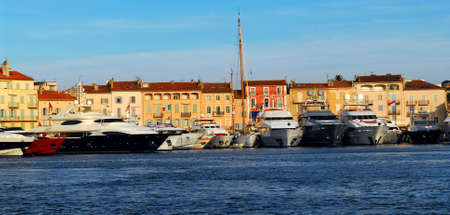 Luxury boats anchored in St. Tropez in French Riviera photo