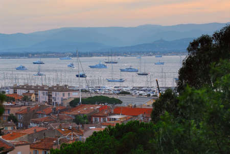 View on St. Tropez harbor in French Riviera at sunset photo
