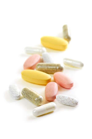 Mix of vitamins and herbal supplements on white background photo