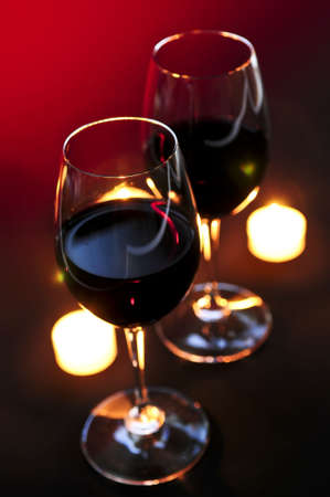 Two wineglasses with red wine at candlelight Stok Fotoğraf