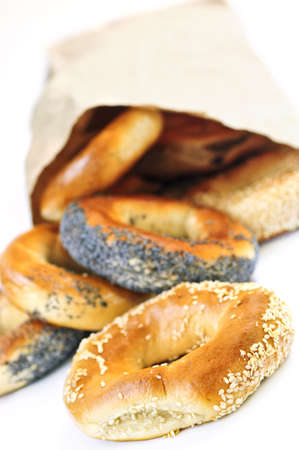 bagels: Fresh Montreal style bagels in paper bag on white background Stock Photo