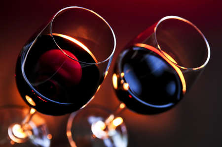 fine dining: Two wineglasses with red wine at candlelight Stock Photo