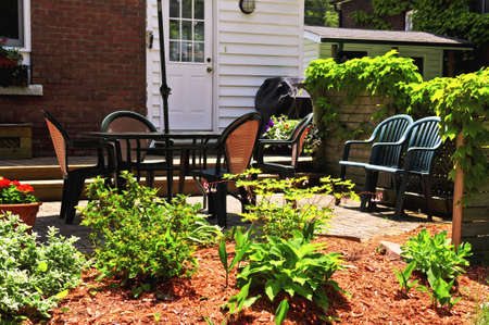 House patio with outdoor furniture and garden photo