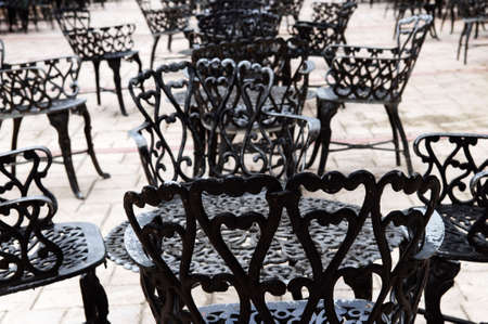 furniture: Wrought iron furniture on the outdoor cafe patio