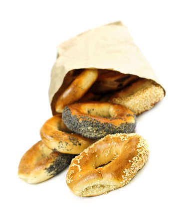 Fresh Montreal style bagels in paper bag on white background photo