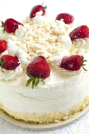 torte: Whole strawberry meringue cake on white background