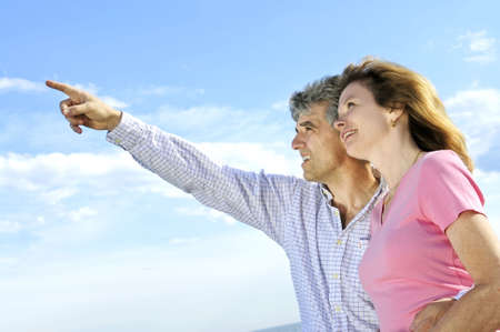 Mature romantic couple of  boomers looking at the sky photo