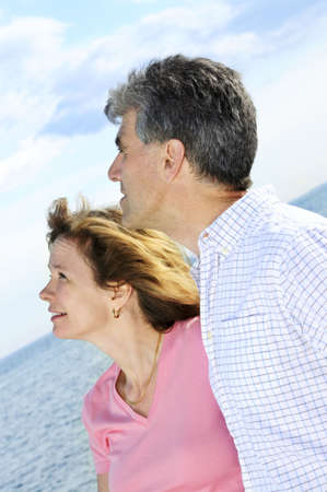 boomers: Mature  couple of  boomers looking at the sky