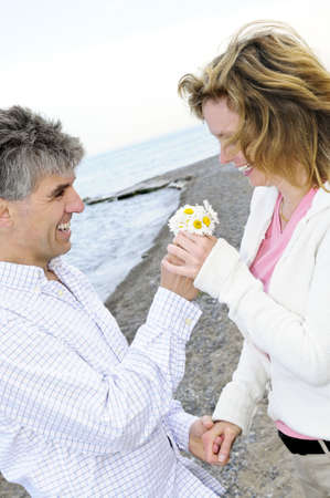 Mature couple enjoying a romantic moment with flowers Stock Photo - 3267791