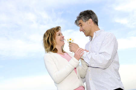 Mature couple enjoying a romantic moment with flowers Stock Photo - 3267764