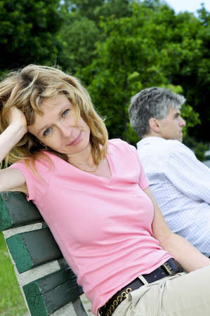 Mature man and woman having relationship problems photo