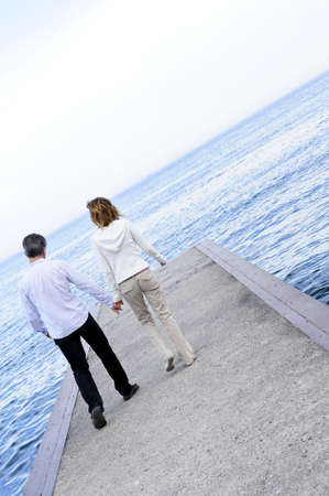 Mature romantic  boomer couple enjoying seashore photo
