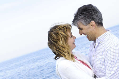 Portrait of mature romantic couple at seashore Stock Photo - 3267779