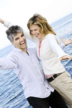 Carefree mature  boomer couple enjoying seashore photo