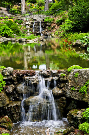 Cascading waterfall and pond in japanese garden Stock Photo - 3267835
