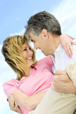 Mature romantic couple of  boomers enjoying outdoors photo