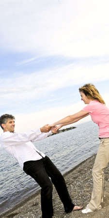 Mature  couple having fun on a beach photo