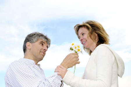 Mature couple enjoying a romantic moment with flowers Stock Photo - 3343617