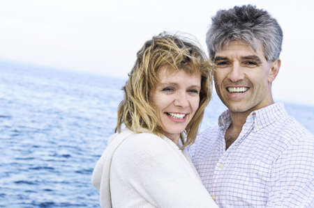 Portrait of mature romantic couple at seashore photo