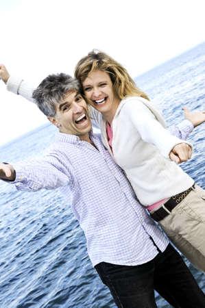Carefree mature  boomer couple enjoying seashore photo