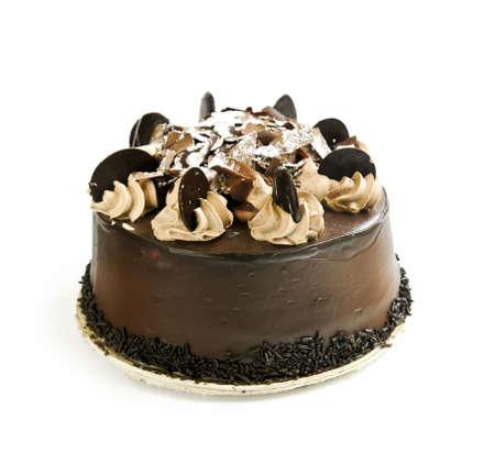cake decorating: Round chocolate cake isolated on white background