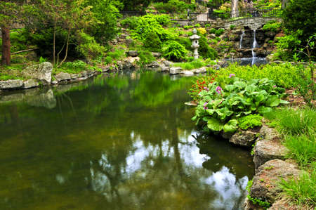Cascading waterfall and pond in japanese garden Stock Photo - 3352462