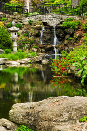 Cascading waterfall and pond in japanese garden Stock Photo - 3352464
