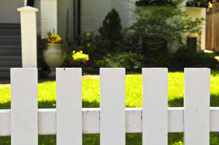 White fence around front yard of residential  photo