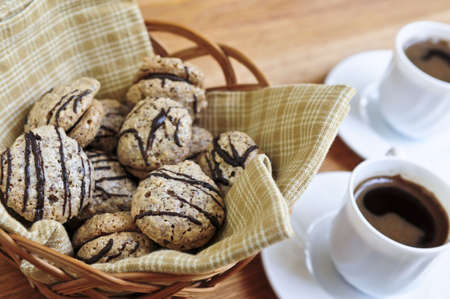 Fresh sandwich cookies in a basket and espresso coffee photo